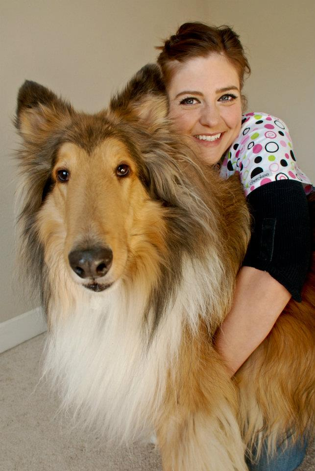 Dr. Alisha Barnes hugging a happy dog after treating by chiropractic care