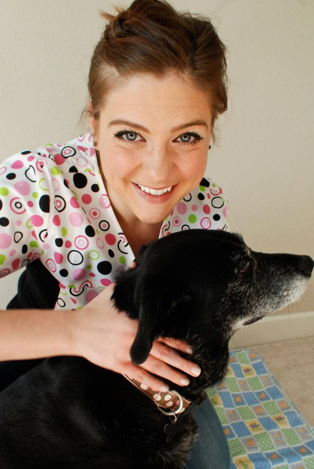 Dr. Alisha Barnes is treating neck pain for a dog by chiropractic care